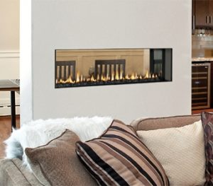 Product shot of a GEMINI 48 C-THRU DV FIREPLACE 8930-0000N in a home on a central wall seen from two rooms